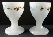 Two cups of alabaster glass, with a painted wreath