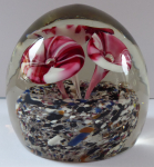 Paperweight with three red and white flowers
