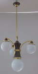 Chandelier with polished brass arms and patinated body