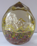 Glass paperweight with silver lion