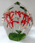 Paperweight with five red flowers and air bubbles