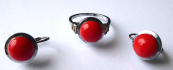 Ring and earrings with red stone