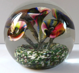 Glass paperweight with five multicolored funnel-shaped flowers