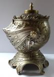 Metal jar, in the shape of a knight's helmet