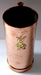 Polished copper tankard with brass initials