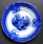 Blue stoneware plate with a peacock - Sarreguemines