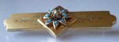 Silver, gold plated brooch with turquoise and river pearl