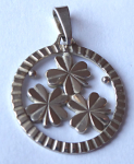 Silver round pendant with four leaf clover