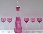Carafe and five tall glasses, clear and pink glass