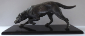Larger statuette of a hunting dog on a black pedestal