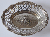 Oval silver bowl, embossed flowers