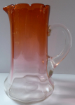 Jug of opal and brick amber glass