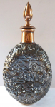 Carafe with patinated copper decorative cover