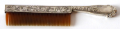 Comb with silver handle and cover