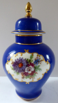 Blue vase with flowers and lid