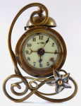 Brass Art Nouveau table clock with alarm clock