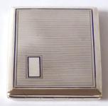 Silver cigarette box, blue line and medallion