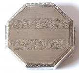 Small silver octagonal powder puff box