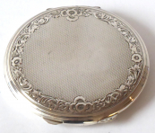 Round silver powder puff box, ornamental circle, guilloche