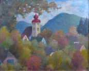 Autumn in small town with a church tower and hills