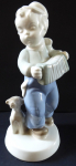 Boy with accordion and dog - Dux