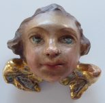 Angel's head with gilded wings