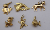 Six gold pendants - animals