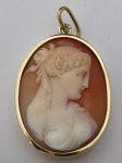 Pendant with cameo in a gold frame