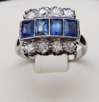 Ring with four blue sapphires and eight diamonds