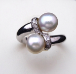 Ring, two sea pearls Akoya, diamonds 0,10 ct