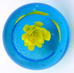 Paperweight, light blue glass with a yellow flower