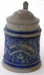 Small ceramic jug, with an inscription