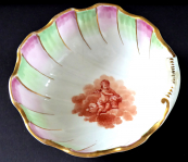 Bowl, conch, with painted angel and red coral