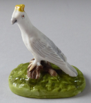 White bird with a yellow crown - porcelain miniature