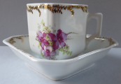 Coffee cup, prismatic in shape, with purple flower