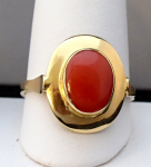 Gold ring with oval red sea coral