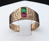 Ring, made of alloy with gold, red and green stone