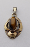 Silver and gilded pendant with a tiger's eye