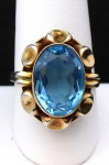Gilded silver ring with blue stone