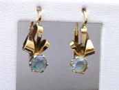 Gold earrings, ribbons, blue spinels