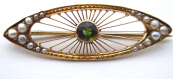 Gold brooch with wires, moldavite and river pearls