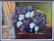 Lilacs in a blue vase on the table by the window