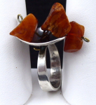 Silver ring with three natural amber