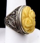 Ring with filigree and rose flowers