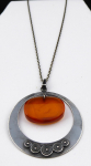 Silver necklace, circle, and oval amber