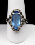 Oval silver ring with blue stone