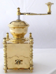 Polished brass coffee grinder, decorative posts