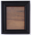 Wooden black frame for a photo, with a stand