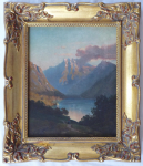 Evening romantic landscape with a figure by a mountain lake