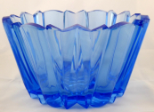 Blue glass bowl in cubist style
